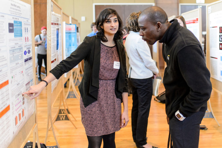 A student presents her research at the Undergraduate Research Symposium.