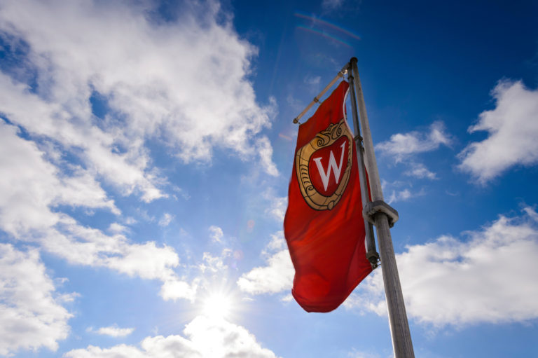 "A ""W"" crest banner flies on Bascom Hill."